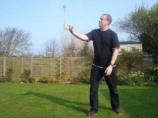 Daddy balancing the baton