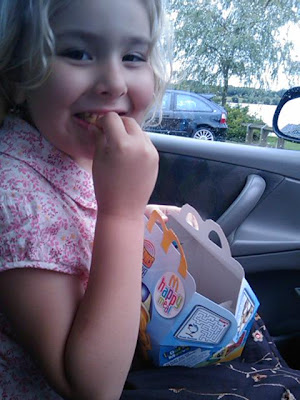 Top Ender eating a McDonalds Happy Meal in the car