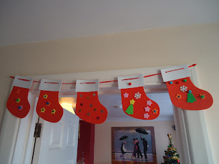 Stocking Garland Hanging above a Doorway