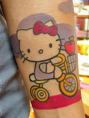 Hello Kitty on a bike tattoo in red and yellow