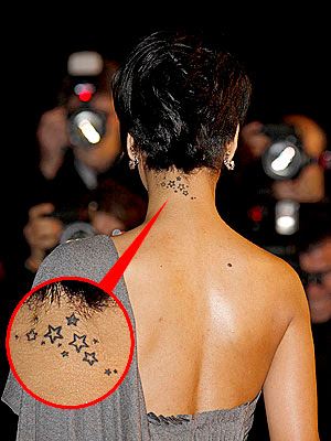 Upper back and neck tattoo of a swallow