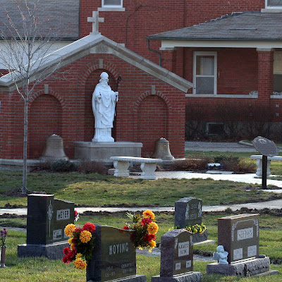 Picture of Saint Patrick Church Memorial with statue of Saint Patrick and Cemetary in the foreground