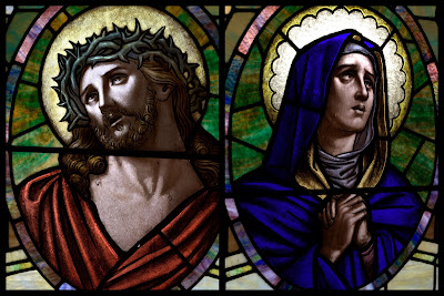 Stained glass window portraits of Jesus crowned with thorns and the Virgin Mary Praying