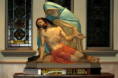 Pieta Statue with Pro Life bumper stickers