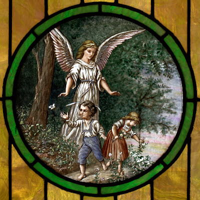 Round stained glass window with small boy and girl playing while an angel watches over them