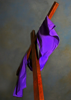 Wooden cross with purple sash