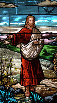 Stained glass window of Jesus sowing seeds