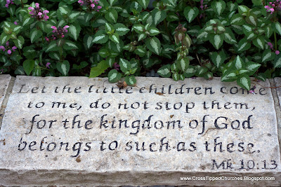 Engraving in stone Let the children come to me, do not stop them, for the Kingdon of God belongs to such as these.