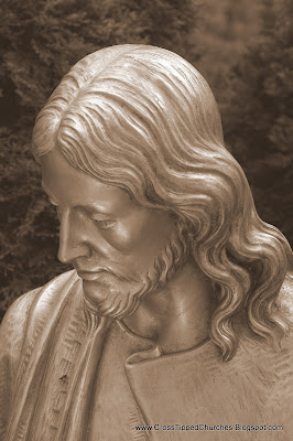 Sepia tone close up of face of Jesus.