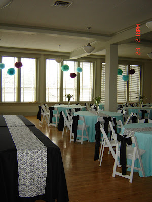This wedding had damask table runners with blue tablecloths