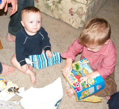 baby opening presents