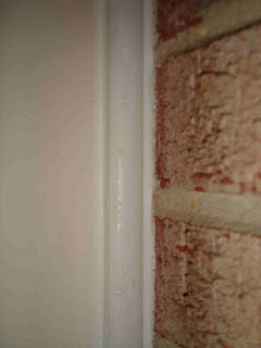 gap between wall and brick sealed