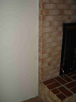 wall to brick fireplace