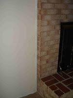 wall to brick fireplace