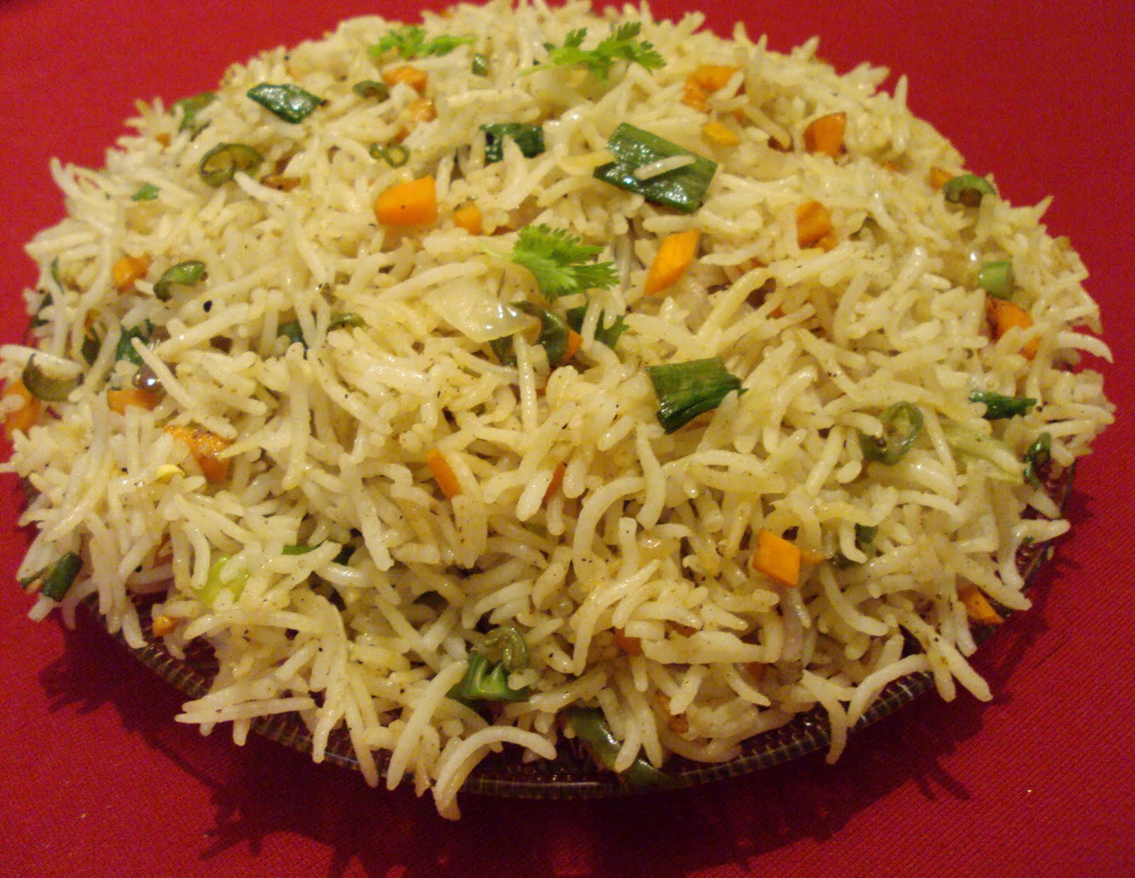 Veg fried rice garnish with remaining spring onion greens freshly chopped coriander leaves and fried cashew ccuart Image collections