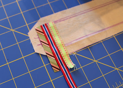 Scrap Ribbon Camera Strap Cover (A Tutorial) step 2 via lilblueboo.com