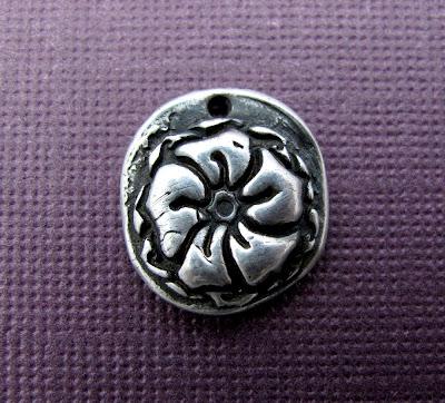 silver flower charm georgia okeeffe jewelry