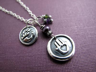 silver phoenix charm heart in hand pendant