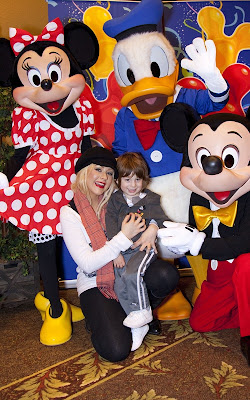 Christina Aguilera and Max celebrating at Disneyland