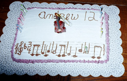 "Violin Cake with Musical Notes, ""Happy Birthday to You""."