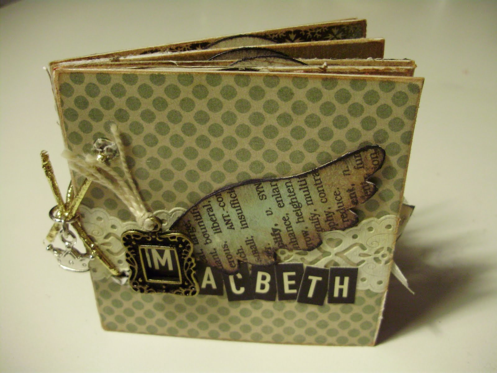 How to make scrapbook for school project - I Kept The Cover Simple But I Just Love How It Turned Out I Used Some Paper Lace A Handmade Wing A Little Dollar Store Frame Charm And Some October