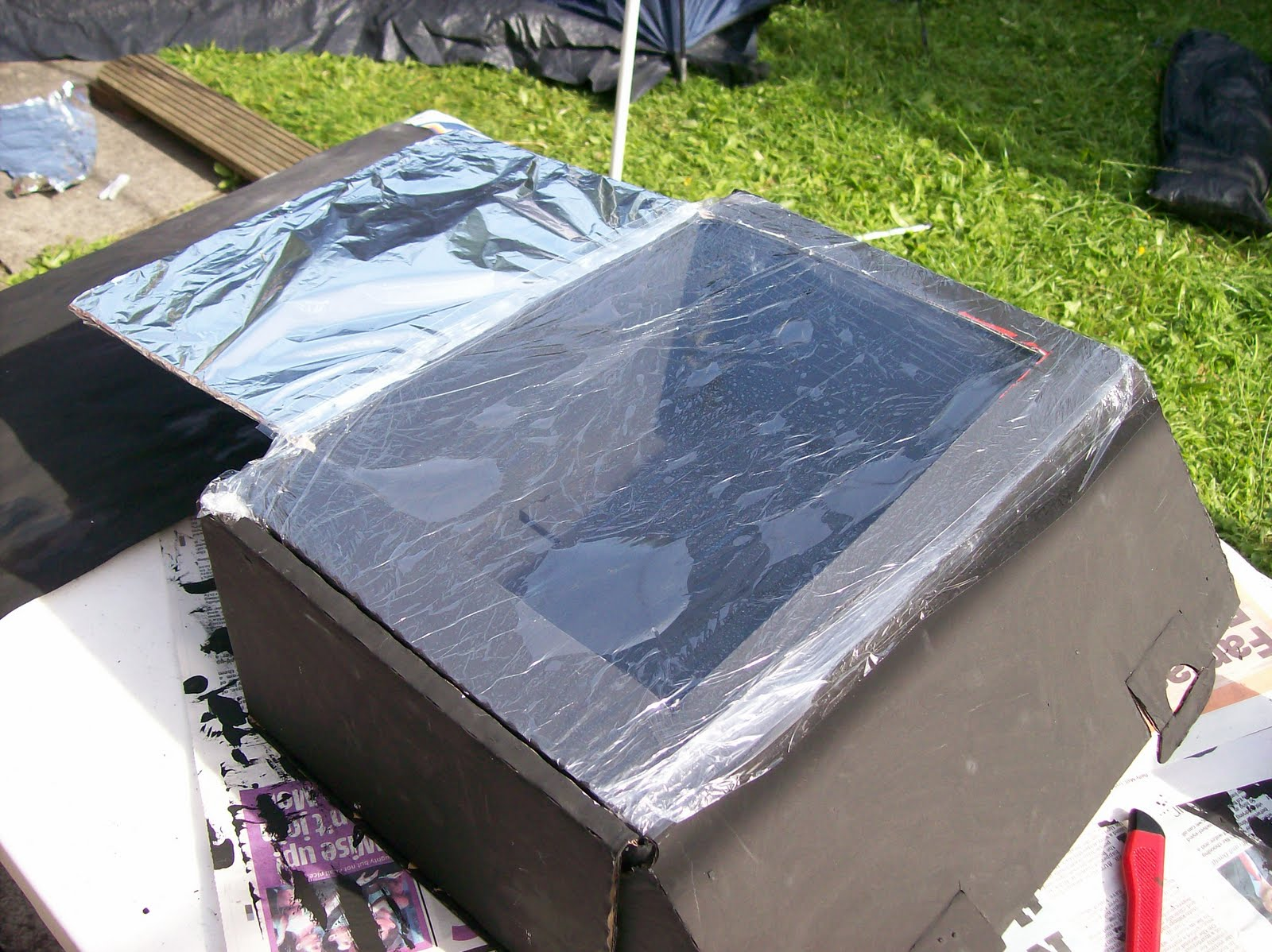 Kid 39 s at play our homemade solar cooker for How to build a solar oven for kids