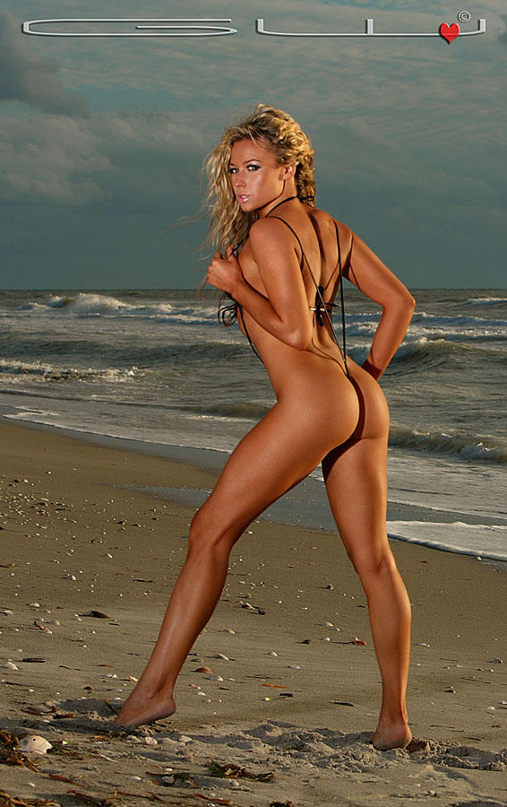 ... is of Jennifer Corliss in a light blue polka dot micro sling bikini.