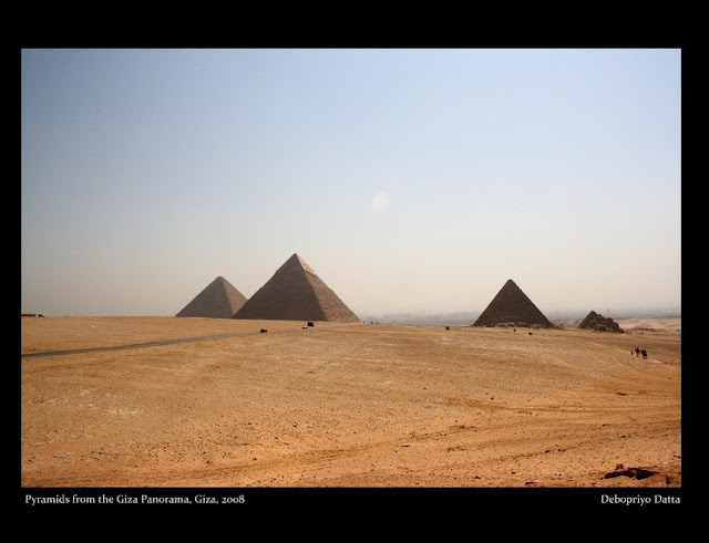 The three pyramids - Khufu's (Cheops), his son Khafre's and Menkaure's. These along with the Sphinx, the funerary temples and the minor pyramids of their queens had completed the entire pyramid complex at Giza or El-Giza.