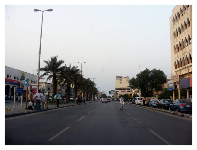 Another shot of the same street. Crossing is a bit tricky as cars drive at 100 kmph down the straight road.  I live behind the large building to the right of the picture. If you remember my earlier post, on the left you can see Samba Bank and Coco restaurant is to the right of the picture.