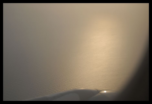 Over the Arabian Sea, with the sun setting