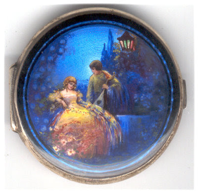 specks of gold all down it. Below Mary's stunning French enamel compact.