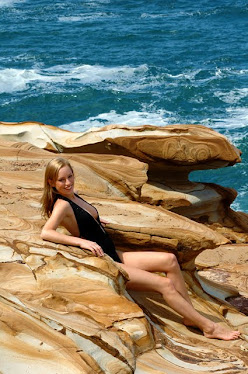 Sunning on rocks next to Putty Beach