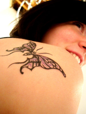 Women Upper Back Dragonfly Tattoo