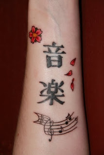 Arm Tattoo Ideas With Japanese Tattoos Especially Cherry Blossom Tattoo Designs With Picture Arm Japanese Cherry Blossom Tattoo Gallery 1