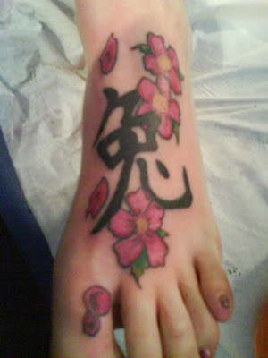 Female Japanese Tattoos With Image Japanese Cherry Blossom Tattoo Designs Especially Japanese Cherry Blossom Foot Tattoo 3