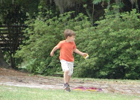 boy trying to fly a kite