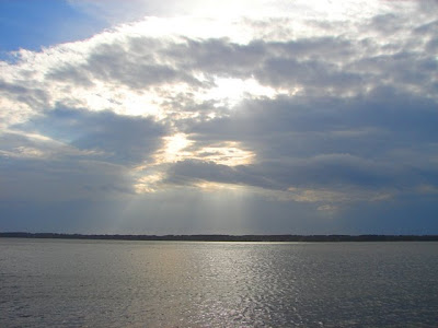 Wonderful crepuscular rays beaming down over the Dania Cutoff Canal in Harbour Town on Hilton Head.
