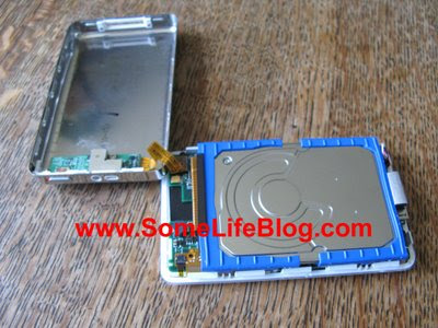 Rotate the case to expose the hard drive on Apple iPod Photo 20GB hard drive replacement