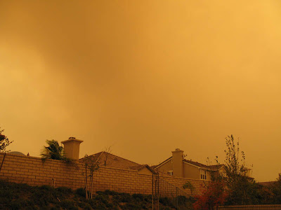 Just more smoke covering our house and backyard.  Raining ash and other debris as we look up towards our hill in the back.