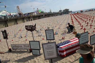 On the Santa Monica beach, they have the Iraq War Memorial where they place crosses for all the soldiers killed in the war.  Quite impacting, seeing all those crosses in the sand.