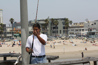 Lots of people were fishing on the Marina Del Rey Pier.  This guy just hooked one when we walked by.