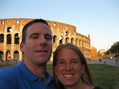We pose for a quick photo in front of the Coliseum as sunset approaches.  The Coliseum is worth seeing as the sun sets and it lights up.