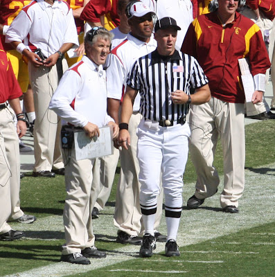 Pete Carroll pauses for a minute to discuss the previous play with the referee.