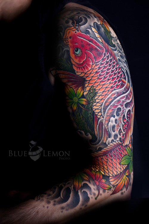 Koi fish sleeve tattoos design is excellent tattoo for mens