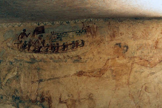 Above him is a depiction of boating on the Nile