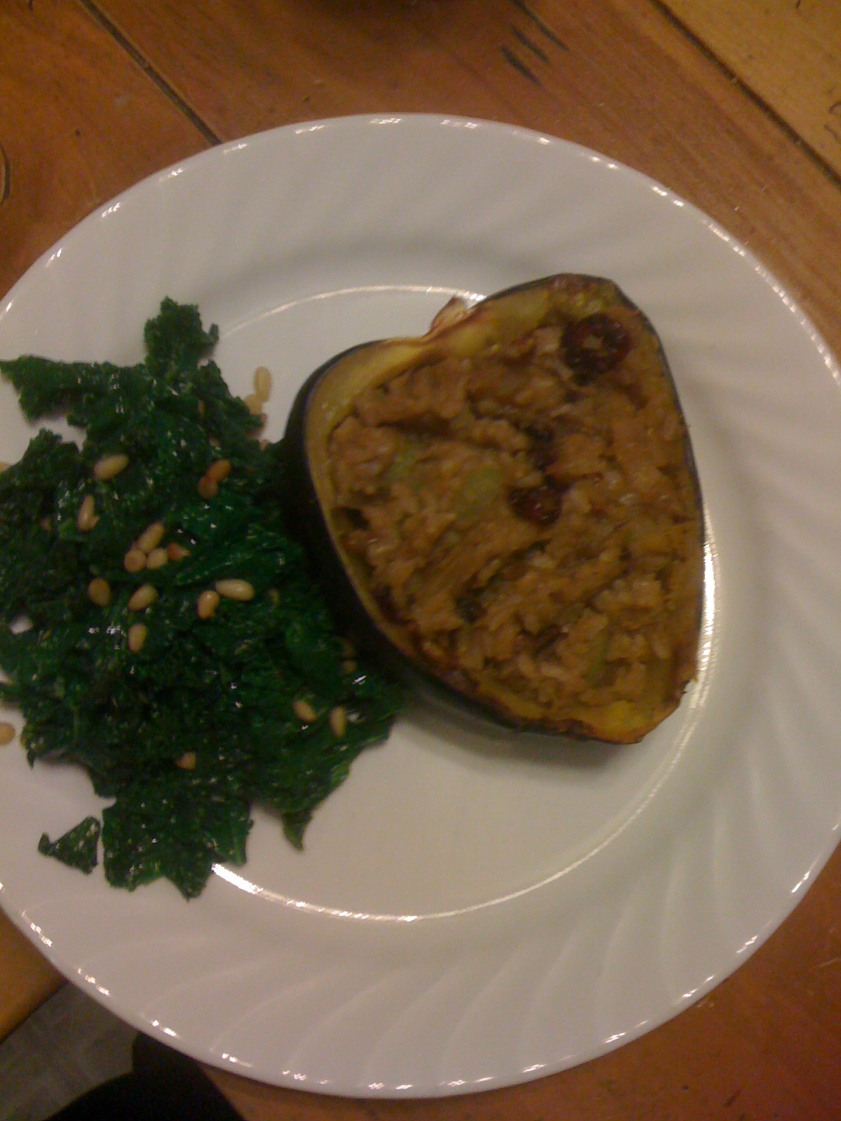 Brown rice stuffed squash with sauteed kale and pine nuts (yes, we are ...