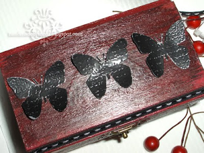 black butterflies on a box