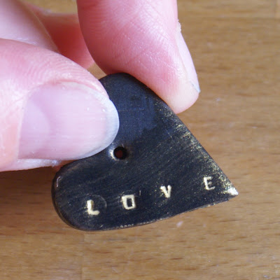 How to use a metal letter stamp set with clay?
