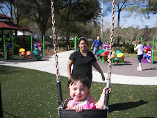 Me pushin Becky on the swing at the park