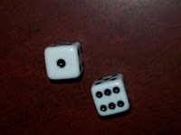Photo of two dice with the sum of 7